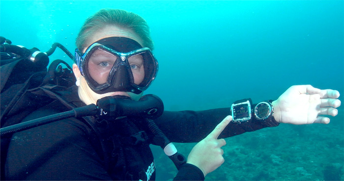 a diver with a dive computer