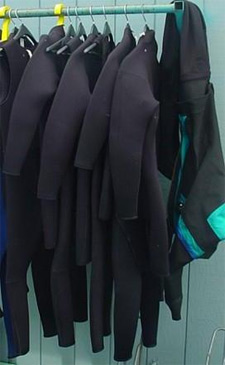 wetsuits hanging